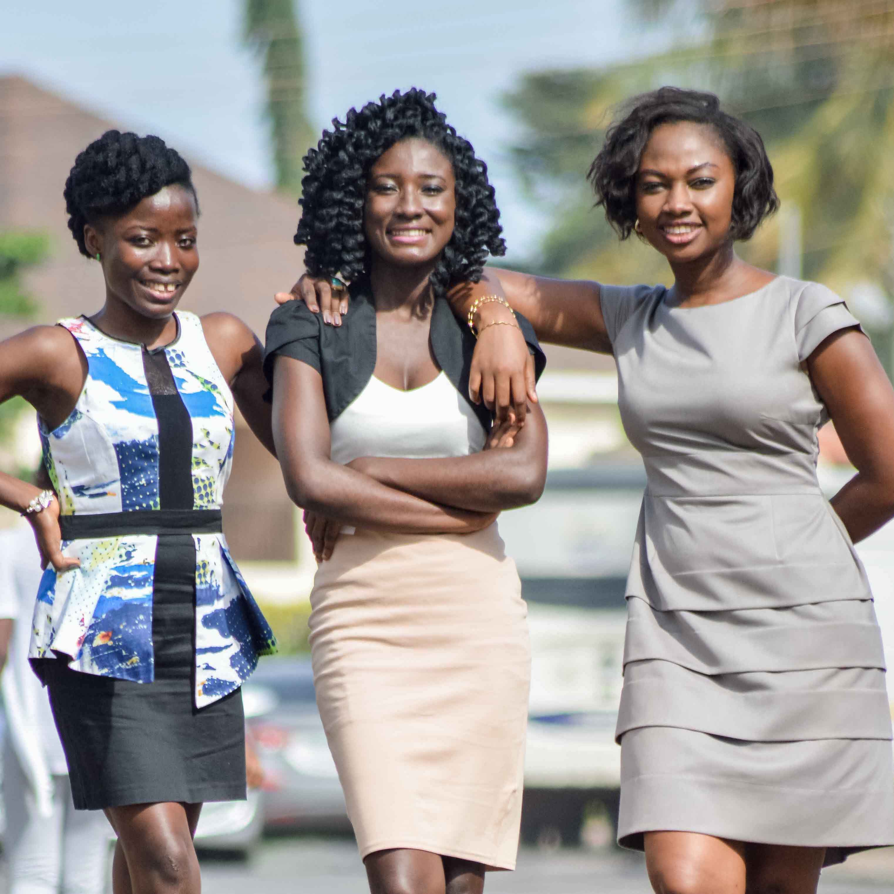 A photo of Priscilla Hazel, Esther Olatunde, and Cassandra Sarfo standing side by side